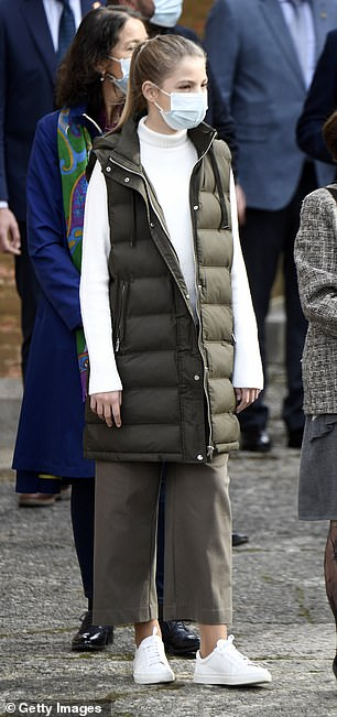 Sofia sported a cosy long padded green gilet over a white turtleneck jumper and completed her outfit with wide leg khaki trousers and white sneakers