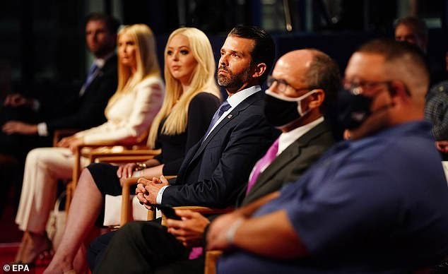 Tiffany, pictured next to her brother Don Jr, is less politically active than her siblings