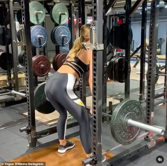Working out: Vogue showed off her impressive strength as she shared the clip of her using various machines and weights during the intense session