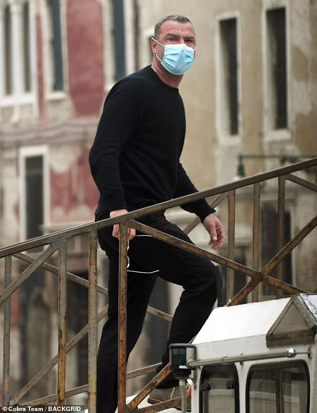 On the go: Liev wore a surgical mask while stepping out, but he appeared to violate Italy's quarantine rules, which require international travelers to stay in their rooms for two weeks