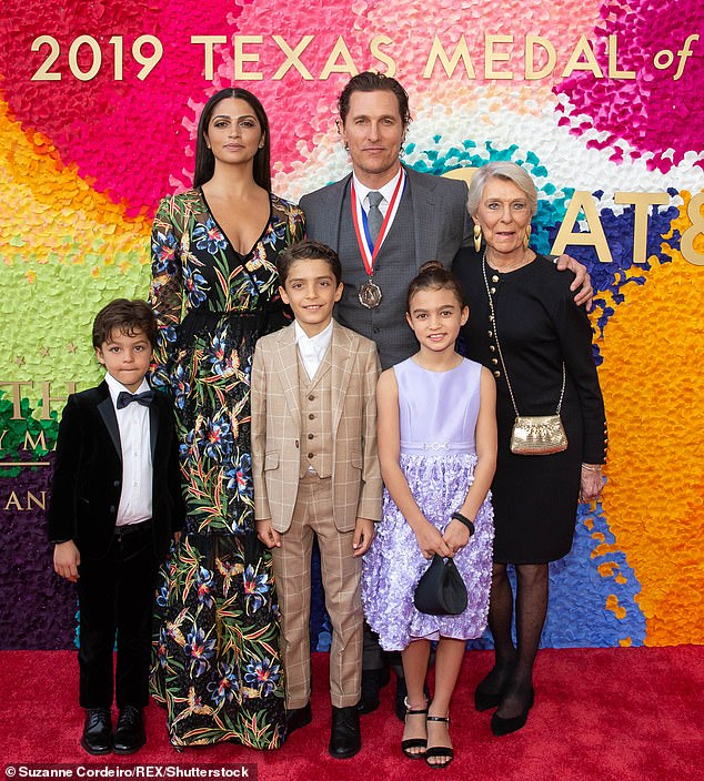 Happy family: While talking about the mother of his three children, Levi, 12, Vida, 10, and Livingston, eight, he says they have `` a love that we never question '' (seen in 2019)