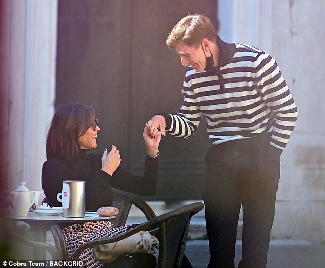 Tuesday: The next day Melanie was seen enjoying an alfresco breakfast in the gondolier's company in the intimate Campo San Toma square