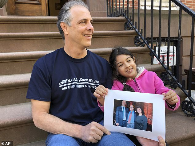 'Ultimately we want an apology and we don't want it to be buried and hidden and forgotten,' Arbeeny said. He is seen alongside his daughter, Salina, who is holding a photo of Norman Arbeeny, 89