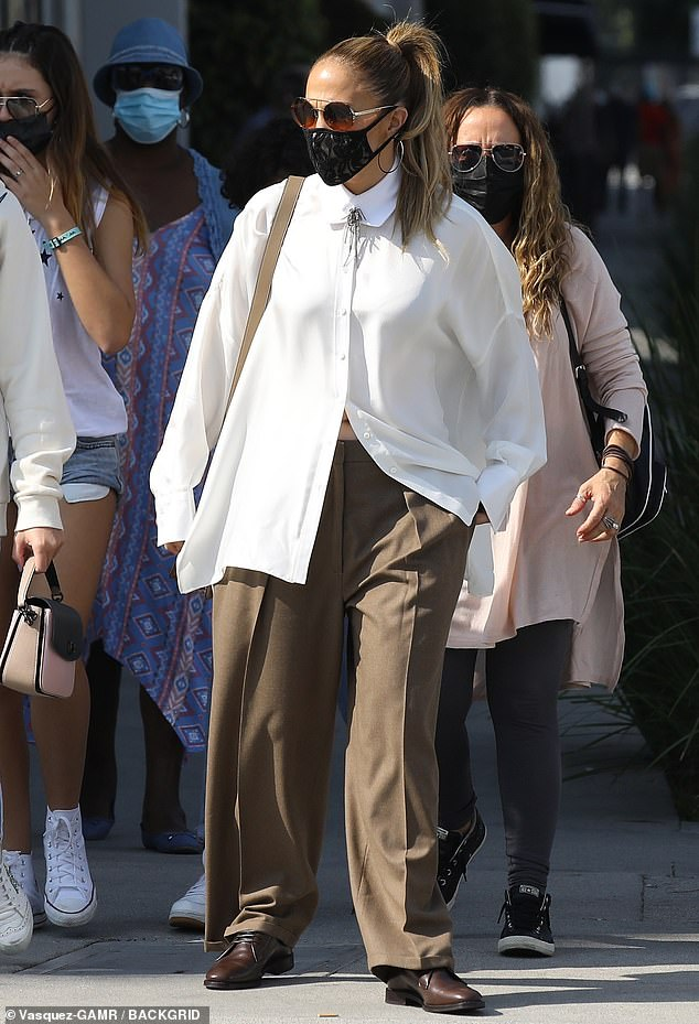 Elegant: Jennifer Lopez was seen enjoying the cooler temperatures in Los Angeles on Saturday, when she was spotted with a posse of women on a shopping trip on ritzy Rodeo Drive