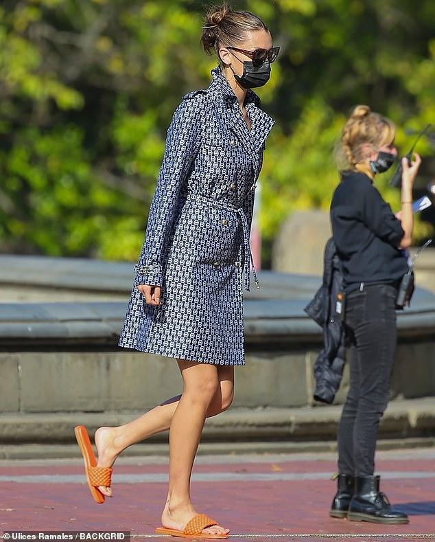Handy: when the cameras weren't with her, however, she was also seen in one spot wearing a mask and a pair of comfortable orange slippers