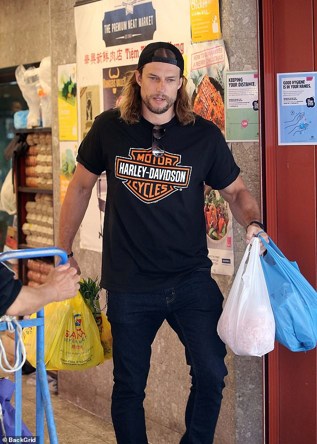 Hunk: Elsewhere, David Genat looked every inch the hunk as he carried bags newly-purchased supplies from the grocery store
