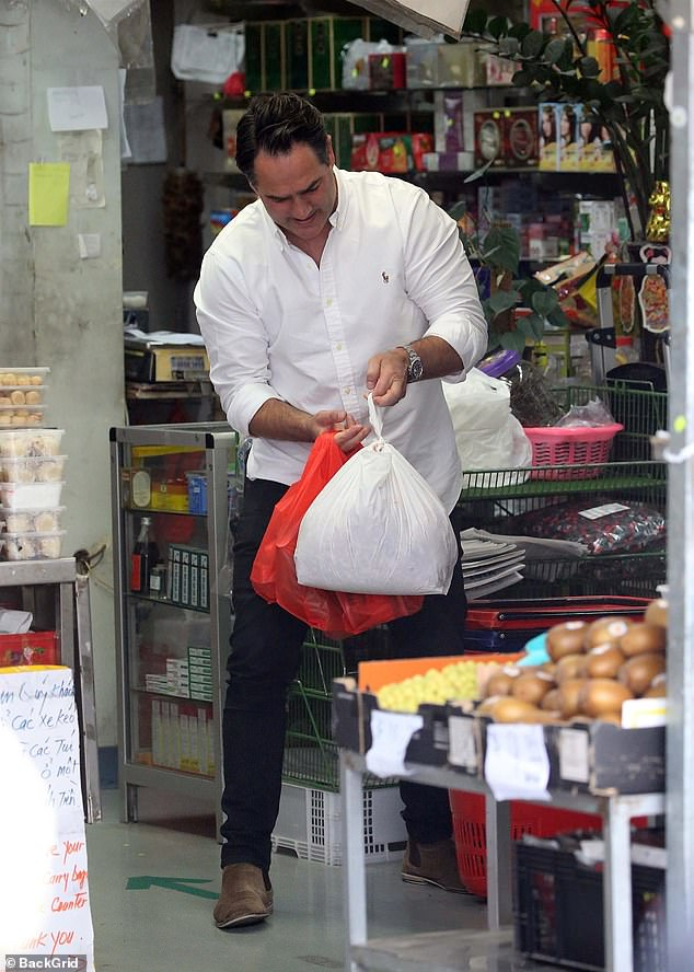 Heavy load:Also seen at the supermarket was radio presenter Michael 'Wippa' Wipfli, who appeared to be struggling with his bags