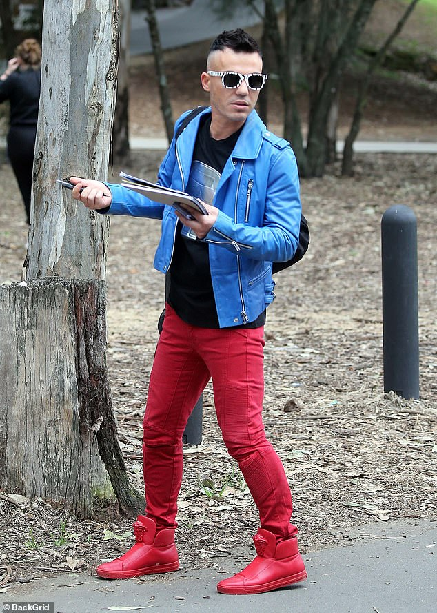 Looking good:Anthony Callea stood out from the pack in a bright blue leather jacket, teamed with a red trousers and matching red shoes