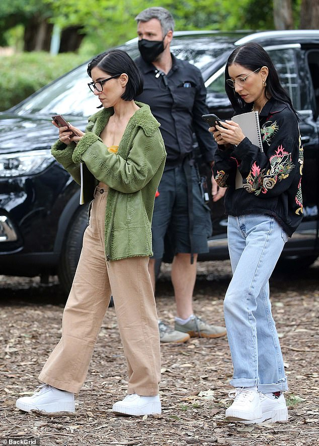 Busy girls:The cast of Celebrity Apprentice Australia were hard at working filming in Cabramatta, Sydney on Friday. Pictured:The Veronicas' Lisa and Jess Origliasso
