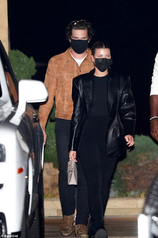 Radiant:Putting safety first with a face mask, the star styled her locks into a chic updo for the evening