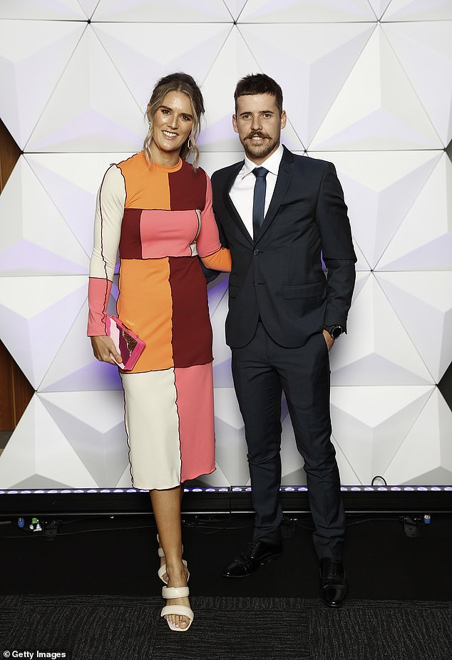 All bright: Jake Lloyd of the Sydney Swans and his partner Zoe Heard at the Sydney event