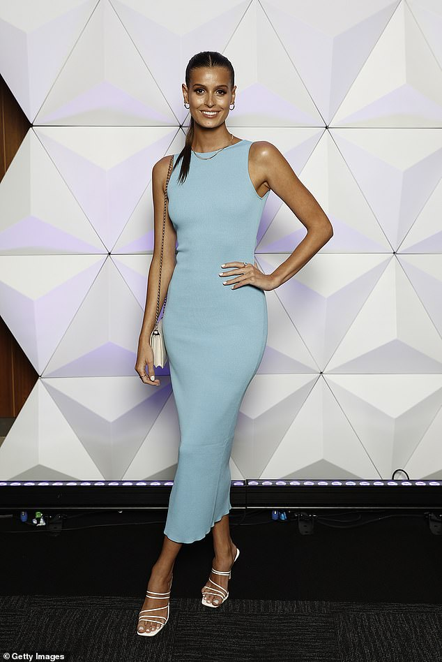 Shining star:The tight dress showed off her figure, and the beauty opted for white heels and gold accessories