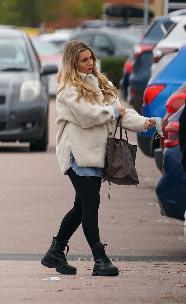 Cosy: Dani kept the autumn cold out in a thick sheepskin jacket, while for footwear she opted for a pair of simple black boots