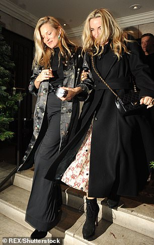 Meg is pictured with A-list pal Kate Moss in 2018