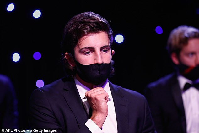 Sombre scenes: Josh Daicos of the Collingwood Magpies looks on wearing a mask during the2020 Brownlow Medal Count at NEP Studios Southbank