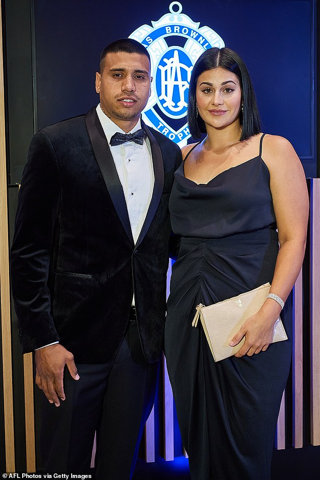 Sultry:Another West Coast Eagles star, Tim Kelly, went along with wife Cailtin Miller who donned a gathered navy blue satin gown and carried a pale clutch