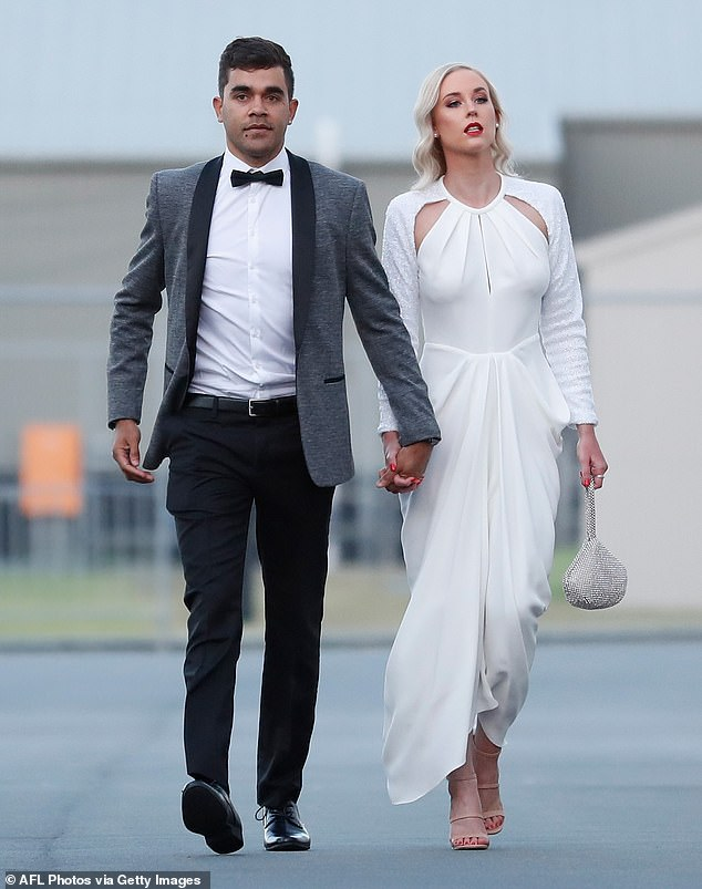 Back to the future:Jack Martin of the Blues and partner Brittany were channelling the 1950s, with Brittany giving off Marilyn Monroe vibes in her white, vintage-style gown, her blonde hair in retro waves and bright red lipstick, and Jack in a slim grey suit with a bow tie