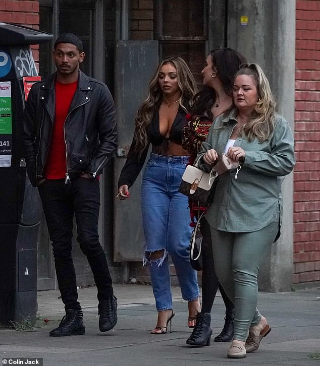 Outfit: The Little Mix singer nailed casual chic on the outing as she donned a black crop top with a plunging neckline that also showed off her toned midriff