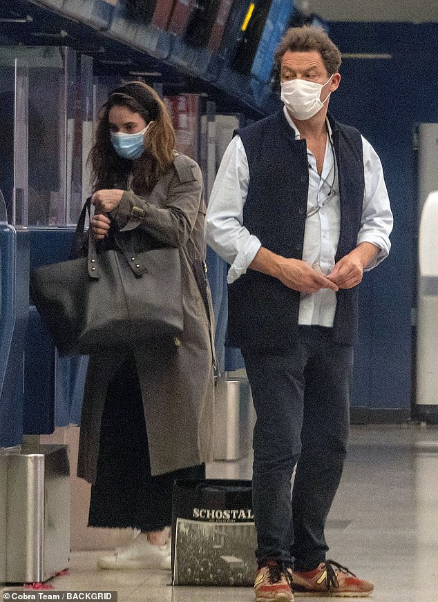 Flying home: Pictures have been unveiled of Dominic West and Lily James at the airport in Rome last Monday, as their romantic getaway came to an end