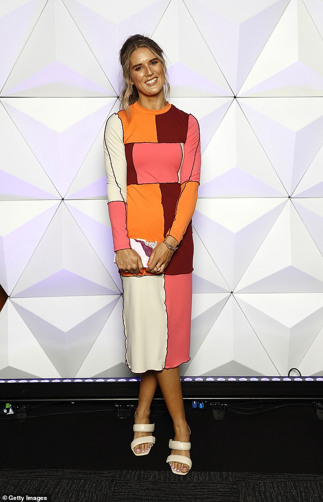 Arty:Zoe opted for an artistic abstract dress in bright block colours, that clung to her slim frame, while wearing her hair in a half-up do