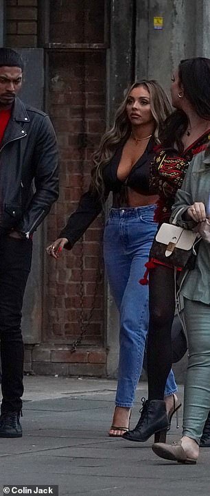 Loved-up: Undeterred by the timing, Sean shared an adorable Instagram snap planting a kiss on Jesy's cheek as she sat on his lap and smiled for the camera