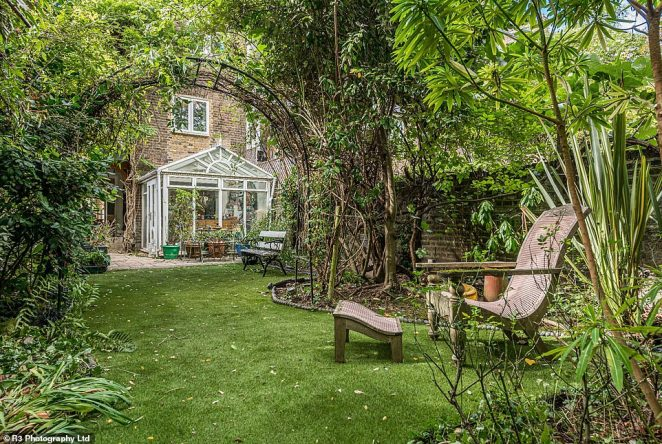The rocker's garden includes a hidden away seating area among hoards of greenery and a garden bench outside the conservatory