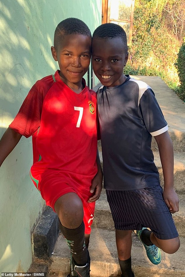 Pictured: Fred and Eliah, the youngest boys in Letty's house. Eliah, was found on the streets in the middle of winter wearing just a T-shirt after his mother passed away. He is now in the top 20 of pupils in his year at his school. Fred, 11, had not eaten for days when he was spotted cowering in a dump. Since moving into the family home in 2019, he's been accepted into a prestigious football academy
