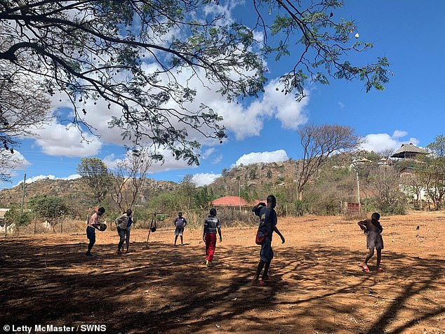 Letty lives in Iringa with the children nine months of the year, coming to the UK for the rest of the year to fundraise through sponsored events and an annual charity ball. Pictured: some of the children playing