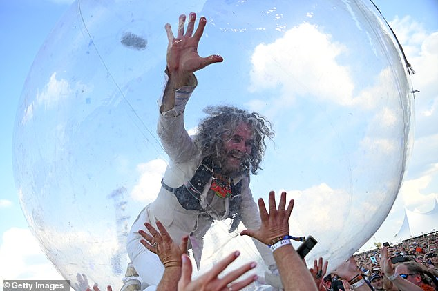 Coyne, pictured in 2019, has been using his own bubble to crowd surf since 2004
