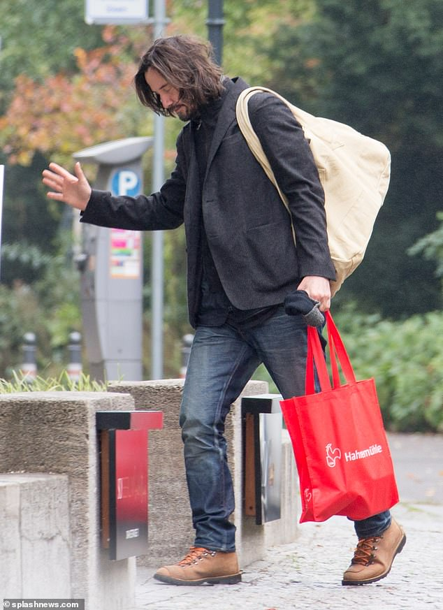 Farewell: Keanu was seen waving goodbye to Alexandra when she drove off and he entered his hotel
