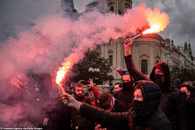 Protesters against the novel coronavirus (Covid-19) measures clash with police in Prague, Czech Republic on October 18