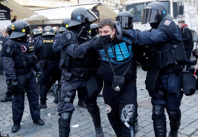 Police makes an arrest during clashes with protesters at the Old Town Square. Czech police used tear gas and a water cannon to disperse a crowd of hundreds of violent protesters who attacked them after a rally in Prague against the government's restrictive measures imposed to slow the spread of the coronavirus infections