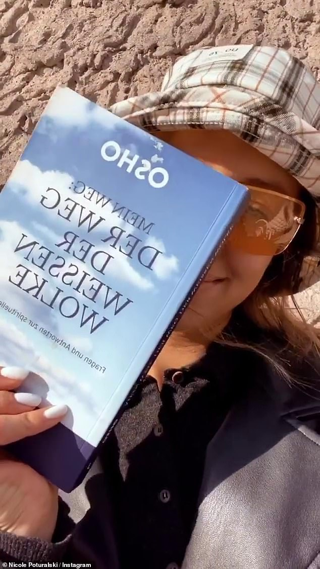 Relax:She took enjoyed the golden hour by filming herself in the sun with shades on as she read a German book