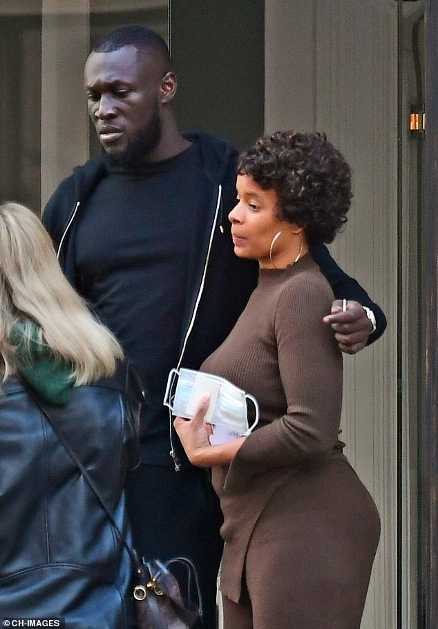 Cultural excursion: Stormzy appeared to be in good spirits as he enjoyed a trip to an Andy Warhol art exhibition at the Halcyon Gallery in London with his assistant on Thursday