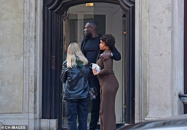 Pals: Stormzy wrapped an arm around her assistant while waiting outside the gallery