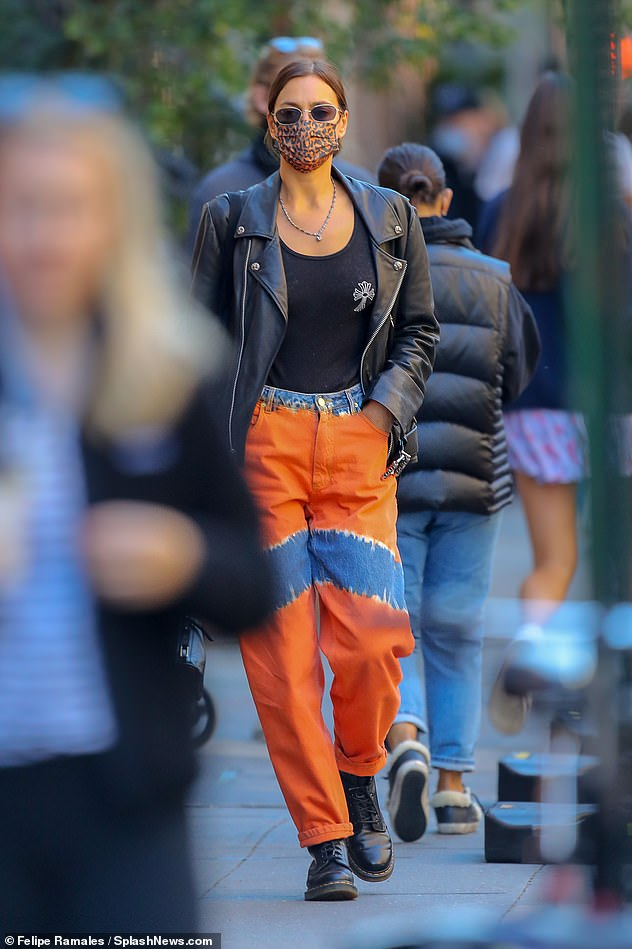Running errands: As she neared her ex Bradley Cooper's NYC apartment, the 34-year-old model looked chic in an oversized black leather jacket and eye-catching pair of jeans