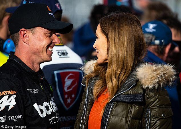 Proud: Kyly, 39, a longtime fan of motorsports and former grid girl, beamed with pride as she supported her boyfriend trackside at the Mount Panorama circuit on Sunday