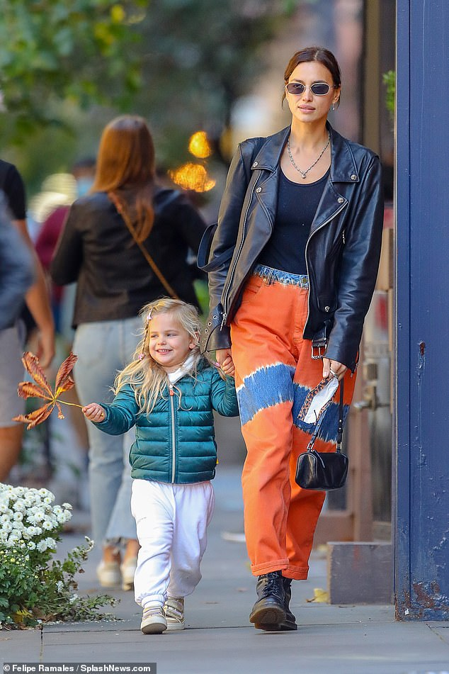 Mommy's mini-me: Irina Shayk embodied the cool NYC-girl aesthetic, as she strutted down the streets in her trusty combat boots on her way to pick up her three-year-old daughter, Lea