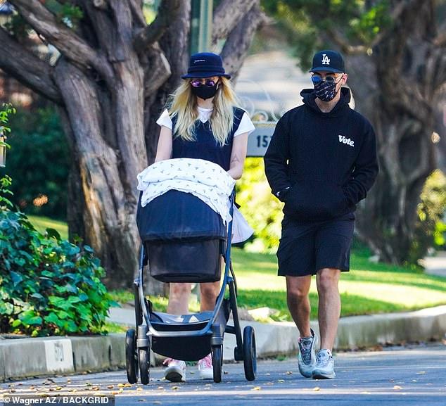Bonding: Sophie Turner and husband Joe Jonas took their nearly three-month-old daughter Willa on a walk through their Los Angeles neighborhood on Sunday