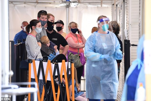 People wait to be tested at the Goulburn Valley Health-Mcintosh COVID-19 testing facility in Shepparton on October 15