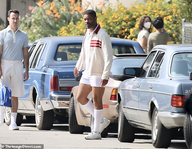 Period piece: The actor was also seen walking among 80s cars on set