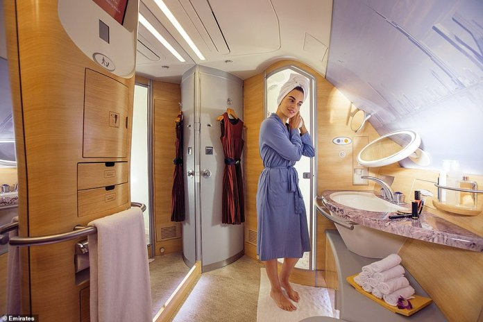 Well-heeled flyers can have a shower again at 40,000ft in Emirates' A380 first-class cabins. Pictured is an Emirates shower spa before the new additional health and safety measures were put in place