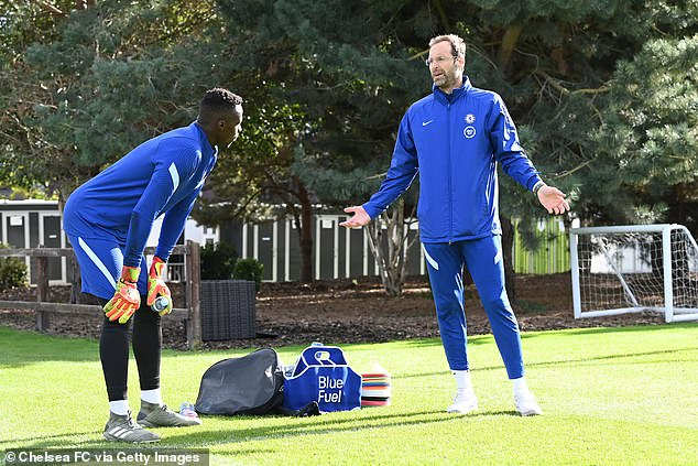 The 38-year-old is in good shape and works with the club's goalkeepers, including summer arrival Edouard Mendy (left) whom he is seen advising during a training session.