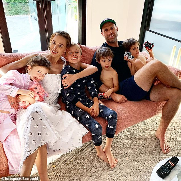 At home: The TV presenter and her husband, retired AFL star Chris Judd, share four children, son Oscar, nine, daughter Billie, six, and four-year-old twins Tom and Darcy (all pictured)