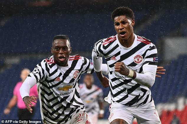 Marcus Rashford (right) made the difference as he scored late to win the game for United