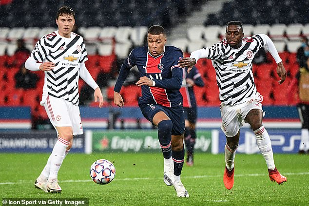 Kylian Mbappe (middle) struggled to make his mark as he was pulled together by United's defense