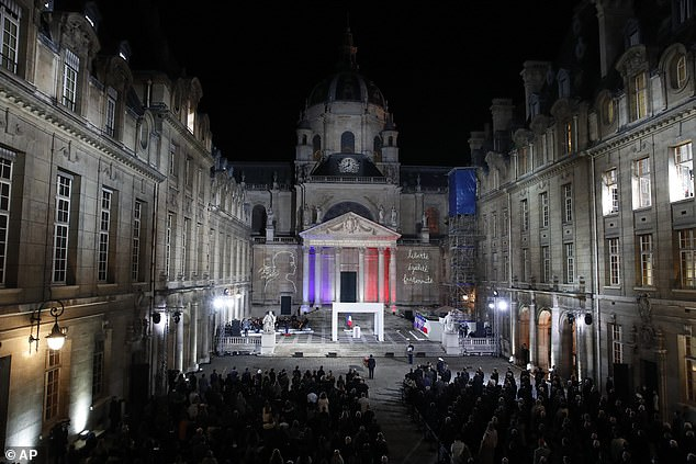 The French President Emmanuel Macron paid his respects in front of the coffin of slain teacher Samuel Paty during the national memorial event last night
