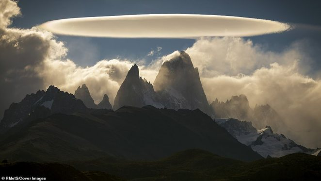 This photograph of clouds above El Chalten, a small mountain village in Argentina, was taken by Francisco Javier Negroni Rodriguez. 'Only for a moment the clouds allowed me to see El Chalten and to my surprise there was a spectacular and brilliant lenticular cloud with a beautiful and perfect figure that I had never seen,' Negroni said