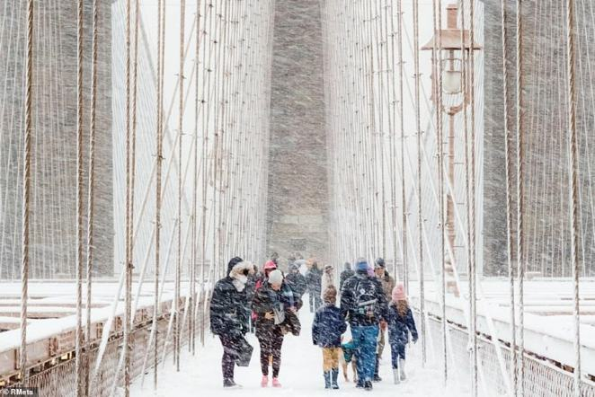 Rudolf Sulgan of New York was named the UK association's Weather Photographer of the Year for his image, 'Blizzard,' depicting pedestrians braving blistering winds and snow on the Brooklyn Bridge