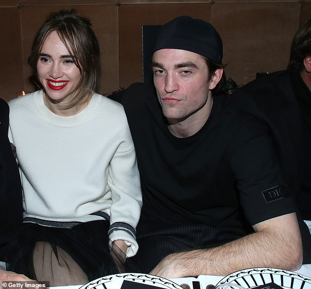 Wedding bells? Robert Pattinson and Suki Waterhouse (pictured in January) 'have discussed getting engaged but are not in a rush to walk down the aisle', it was claimed on Wednesday